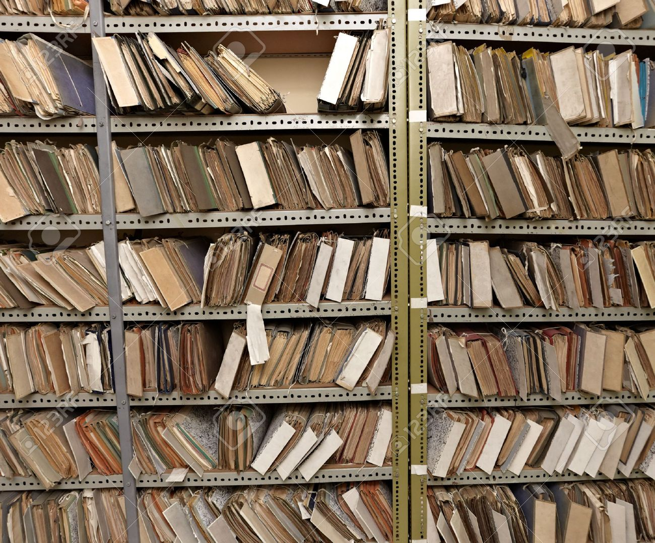 12271257-close-up-of-old-vintage-files-in-a-storage-room-Stock-Photo-file-archive-old